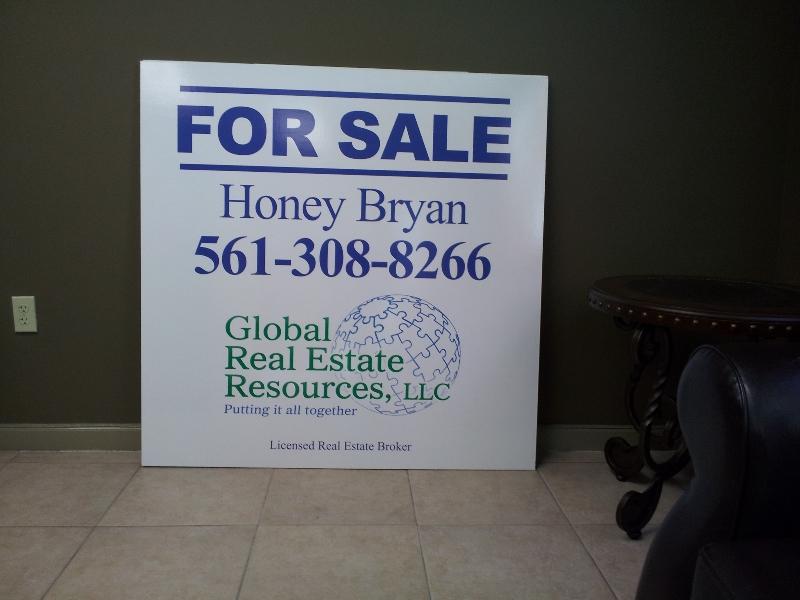 global-real-estate-honey-for-sale-sign